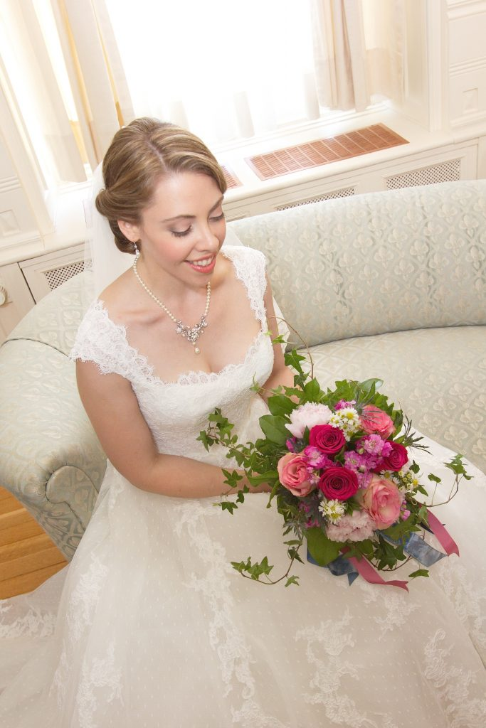 Bride with DIY wedding bouquet in pinks and white