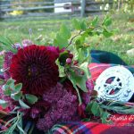 Loose, rustic Outlander bouquet in red and pink