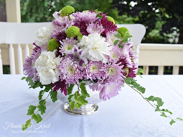 A gorgeous purple, white, and green DIY arrangement | flourishandknot.com