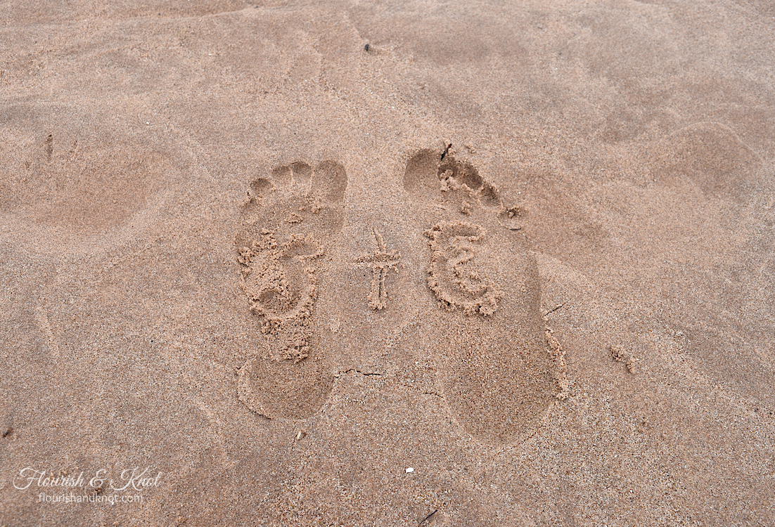 Our footprints in the sand at Cavendish Beach, PEI