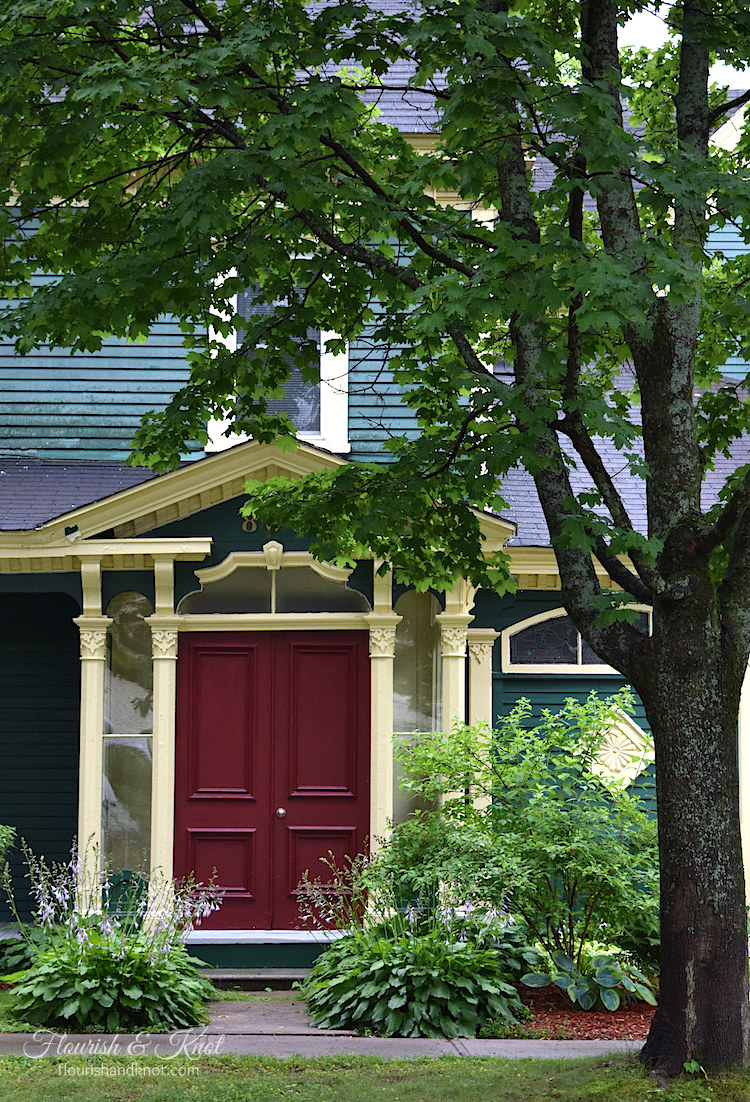 Heritage home in Fredericton, New Brunswick, with a green, cream, and red colour scheme