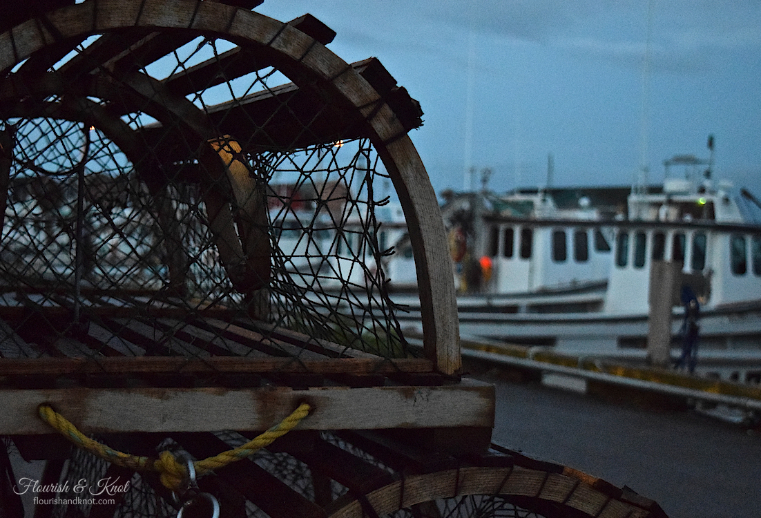 Lobster traps piled up in the harbour at dusk in Malpeque, PEI