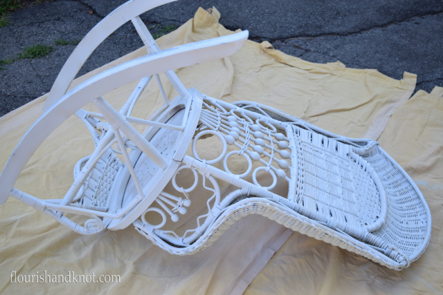 An antique rocking chair getting a spray paint makeover in bright white!