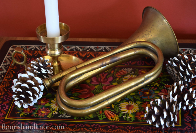 Flourish & Knot's 2015 Christmas Home Tour | flourishandknot.com | Brass trumpet on a red painted tray with pinecones