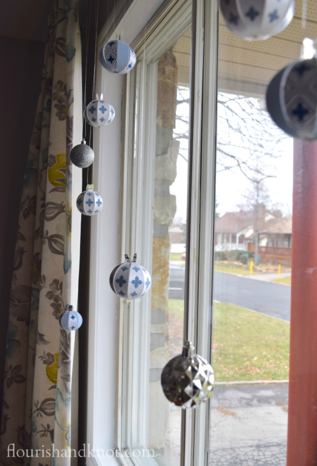 Flourish & Knot's 2015 Christmas Home Tour | flourishandknot.com | Blue, white, and silver Christmas ornaments hanging in my window