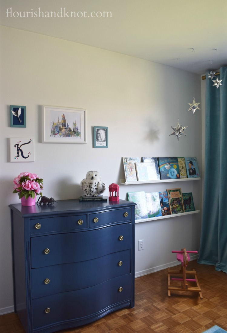 Navy, turquoise, pink, and white Harry Potter nursery with navy dresser | flourishandknot.com