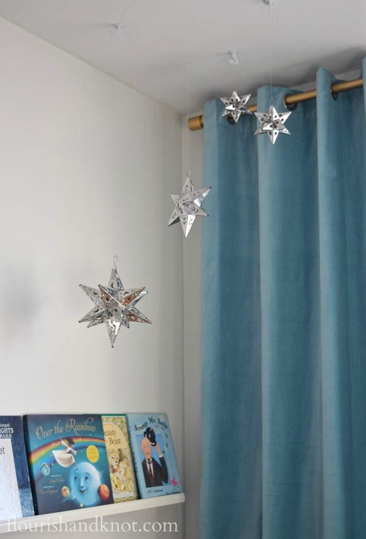 Mexican tin star mobile in our Harry Potter nursery | flourishandknot.com