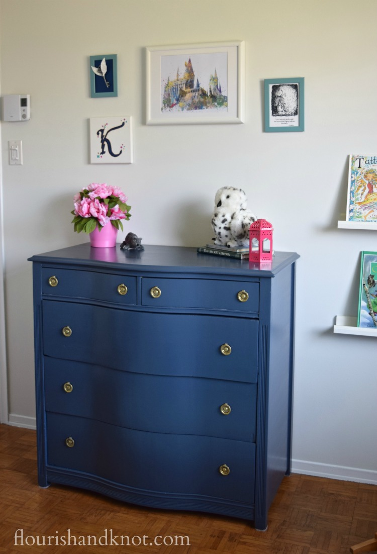 Navy blue dresser with Harry Potter gallery wall and pink accents | flourishandknot.com