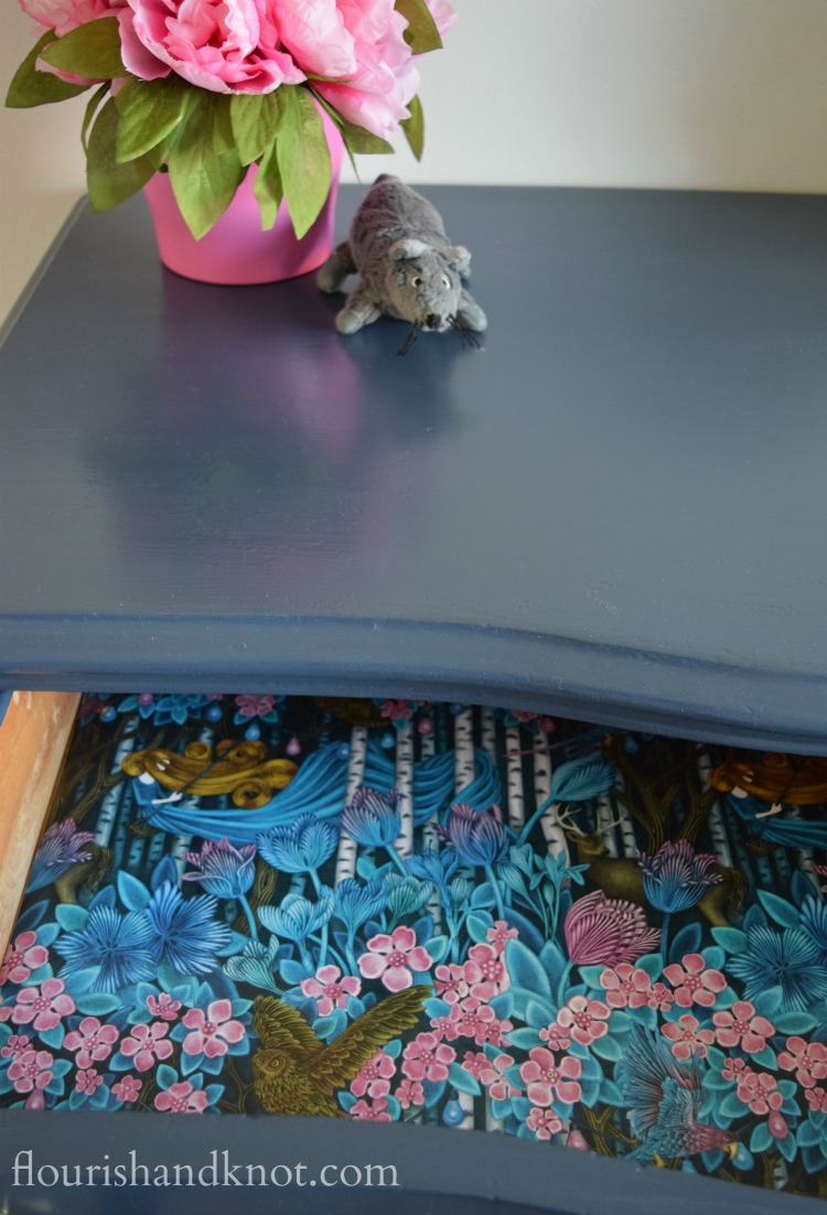 Interior of our navy dresser with magical forest lining paper | flourishandknot.com