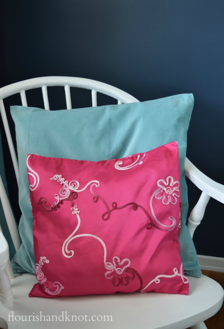 DIY pink and turquoise cushions in our Harry Potter nursery | flourishandknot.com