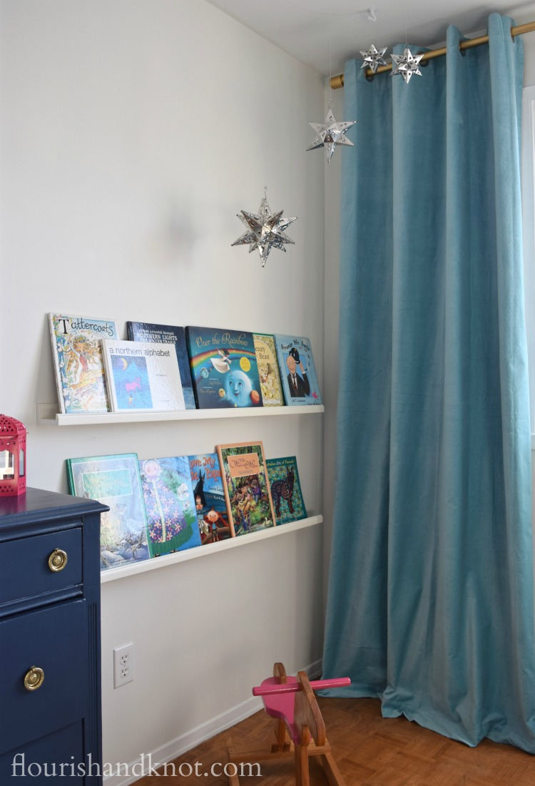 Navy, turquoise, pink, and white Harry Potter nursery with Mexican tine star mobilel | flourishandknot.com