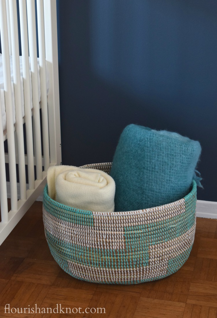 Woven turquoise and white basket from UncommonGoods | flourishandknot.com