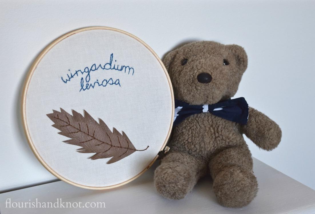 Teddy bear with lighting bolt bow tie and Wingardium Leviosa embroidery hoop