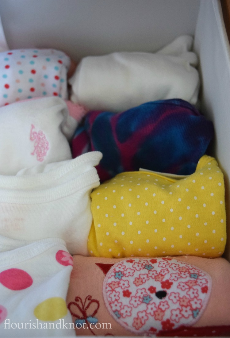 Rolling Baby's onesies saves a lot of dresser drawer space! | 5 Ways I'm Getting Ready for Baby | flourishandknot.com