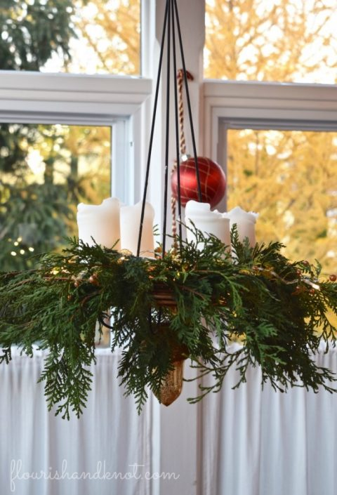 Add greenery to your chandelier | 7 (Unbelievably) Simple Holiday Decor Ideas | Easy Christmas Decor | Vankleek Hill Christmas Home Tour | flourishandknot.com