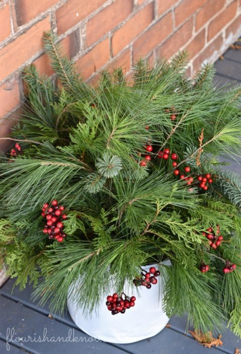Christmas planter with greenery and berries | 7 (Unbelievably) Simple Holiday Decor Ideas | Easy Christmas Decor | Vankleek Hill Christmas Home Tour | flourishandknot.com