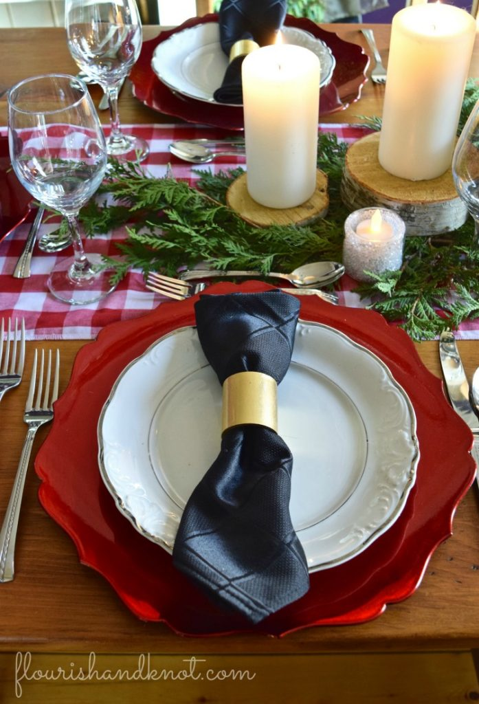 Christmas table with red chargers, black napkins, and rustic candles | Rustic Farmhouse Christmas Decor | 3 Inspiring Ways to Decorate for Christmas