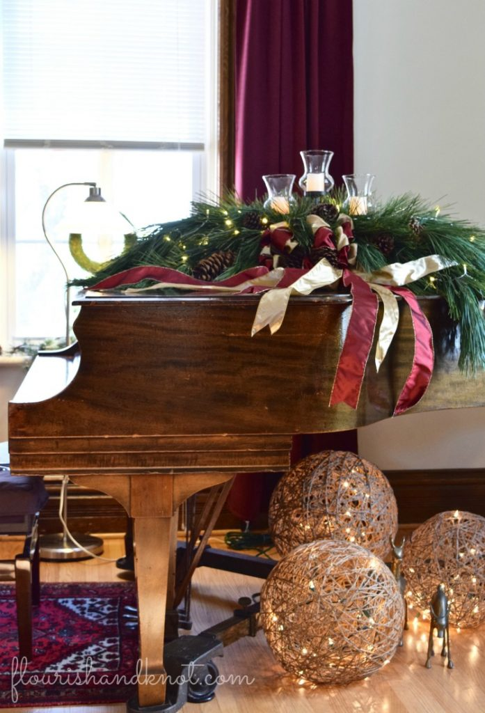 A grand piano decorated with Christmas greenery | Traditional & Classic Christmas Decor | 3 Inspiring Ways to Decorate for Christmas