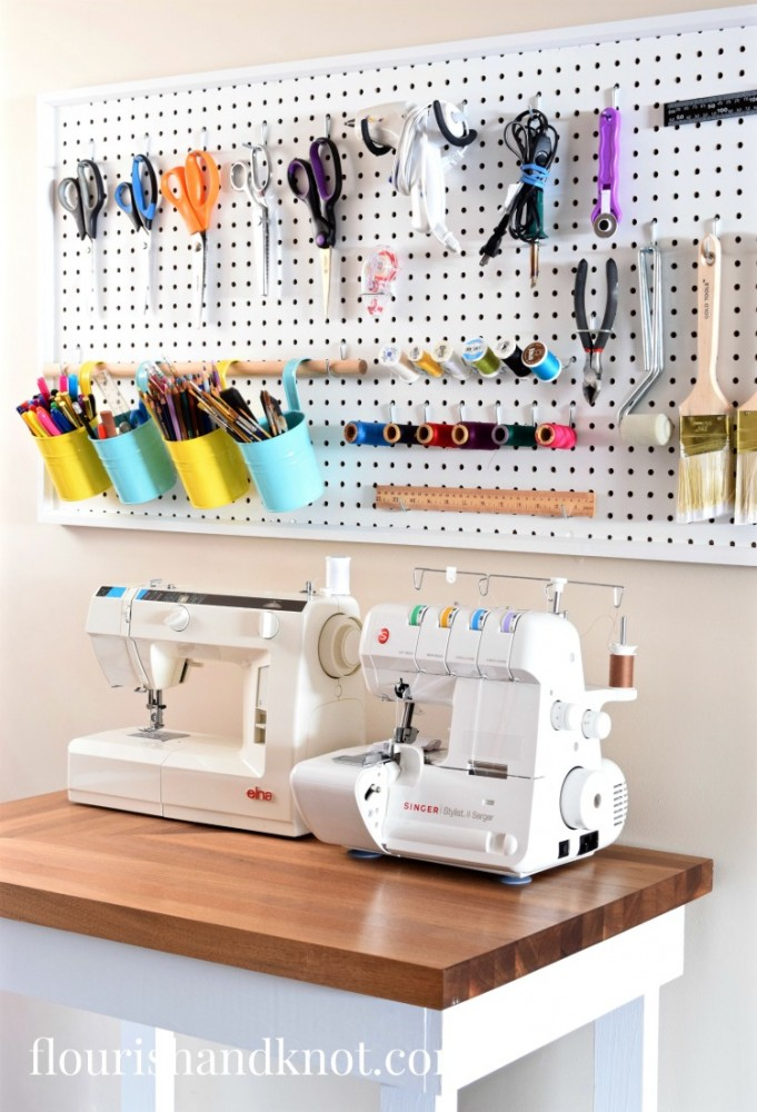 https://flourishandknot.com/wp-content/uploads/2017/03/Craft-and-sewing-room-makeover-sewing-area-with-pegboard.jpg