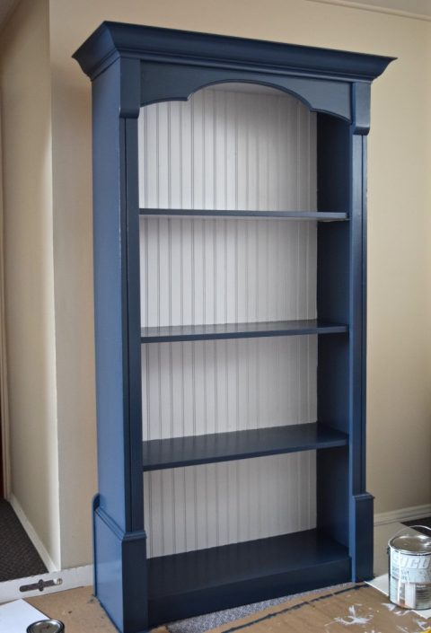 Navy blue and white painted bookcase | $100 Craft & Sewing Room Makeover | $100 Room Challenge | Navy, Goldenrod, and Fuschia palette | Week 3