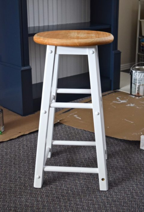 Half-painted white and natural wood barstool | $100 Craft & Sewing Room Makeover | $100 Room Challenge | Navy, Goldenrod, and Fuschia palette | Week 3