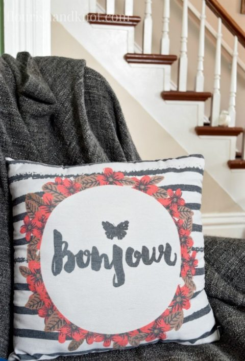"""Bonjour"" pillow and grey throw from Giant Tiger 