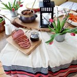 Red, White, and Black table setting with tulips and lantern | Tourtiere (meat pie) | Sugar Shack Lunch | Cabane a sucre menu | A Year of Feasting - Spring | Traditional Canadian Quebec meal