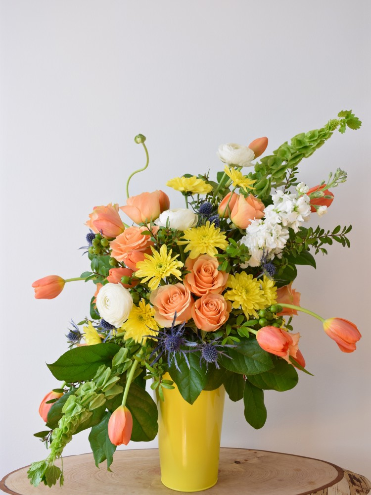 Spring Time Arrangement in Coral, Yellow, Blue, and White