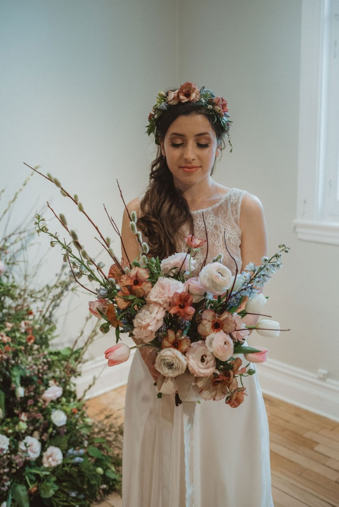 Asymmetrical spring bouquet with pussy willows, delphinium, ranunculus, lisianthus, and tulips | Flourish & Knot | Burgundy, blue, and blush bouquet