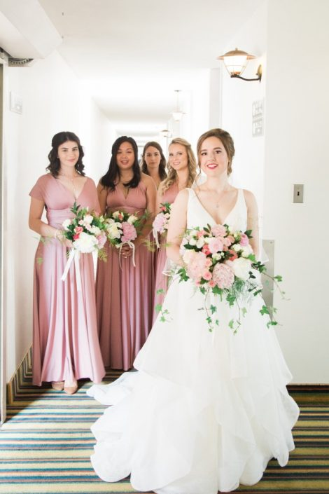 Elegant summer wedding with pink peony and rose bridal bouquet, bridal party in rose dresses with bouquets | Photo by Cassandre Poblah | Classic pink and white wedding | Hotel Mont Gabriel Wedding