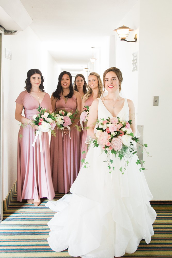 Elegant summer wedding with pink peony and rose bridal bouquet, bridal party in rose dresses with bouquets | Photo by Cassandre Poblah