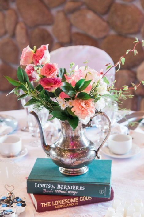 Floral centrepiece in vintage coffee pot with roses, ranunculus and sweet peas | Photo by Cassandre Poblah