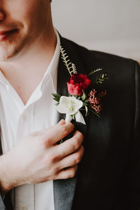 Groom's Boutonniere in Burgundy and White | Hellebore and tulip boutonniere Florals by Flourish & Knot | Photo by Photographie M'Vivre