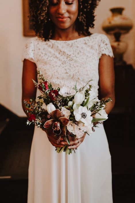 Bridal bouquet in burgundy, brown, white, red, and green | Orchid anemone tulip and hellebore bouquet | winter wedding bouquet | Florals by Flourish & Knot | Photo by Photographie M'Vivre
