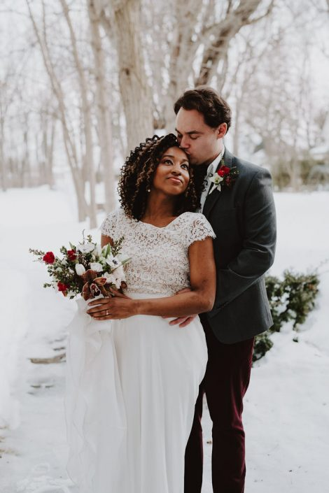Winter wedding couple | Burgundy, red, and white winter wedding | Bridal bouquet of tulips, anemones, hellebore | Florals by Flourish & Knot | Photo by Photographie M'Vivre