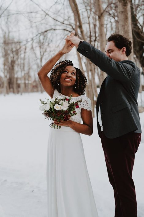 Winter wedding couple | Burgundy, red, and white winter wedding | Bridal bouquet of tulips, anemones, hellebore | Florals by Flourish & Knot | Photo by Photographie M'Vivre | Maison Trestler | Gown by Robelie | Makeup by Chrom Artistry