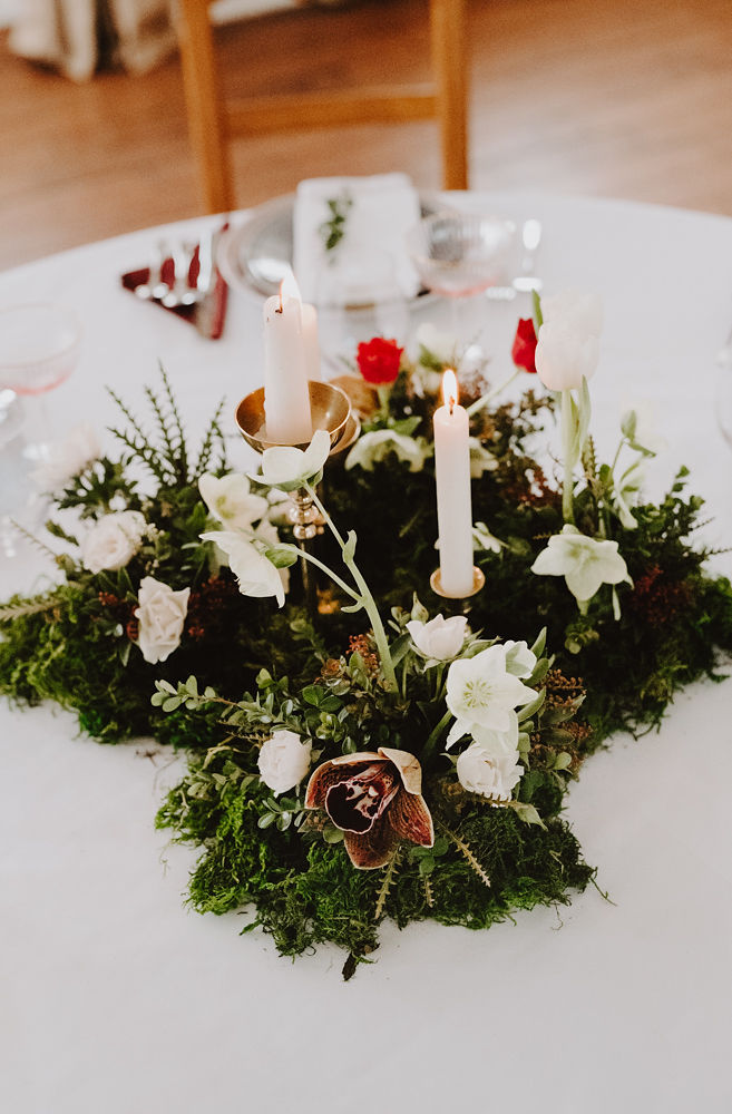 Woodland floral centrepiece with moss, orchids, tulips, and hellebore | Florals by Flourish & Knot | Photo by Photographie M'Vivre