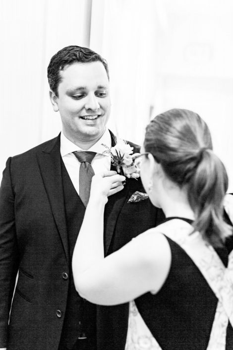 How to Choose your Wedding Vendors | Montreal Wedding Florist | Flourish & Knot | Pinning a boutonnière | Photo by Danylo Bobyk Photography