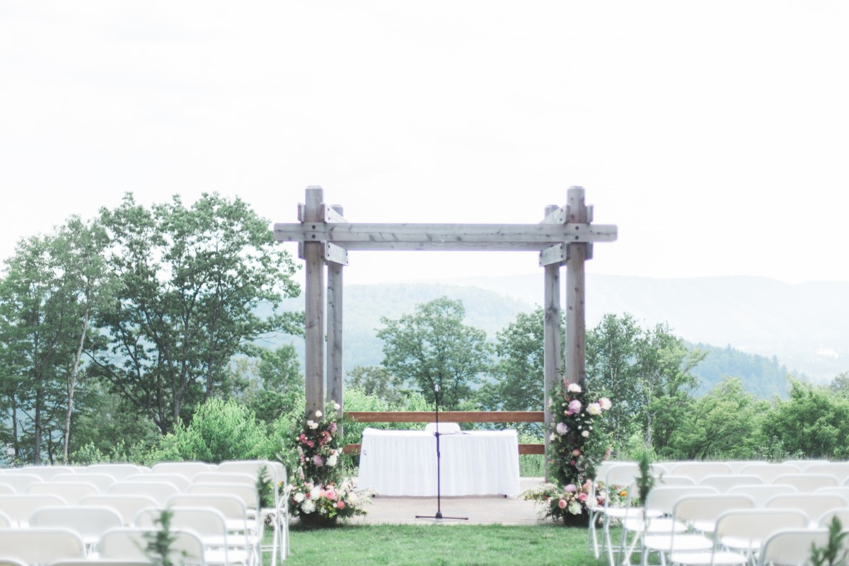 Foam-free floral installation for wedding arch with peonies and roses | Hotel Mont Gabriel Wedding | Flourish & Knot | Cassandre Poblah Photography