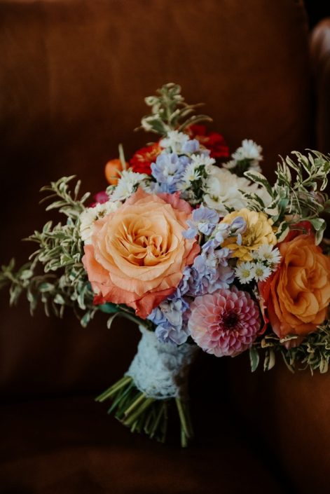 Bright and colourful bridal bouquet with Free Spirit roses, dahlias, and zinnias | Rainbow colour bridal bouquet | Flourish & Knot
