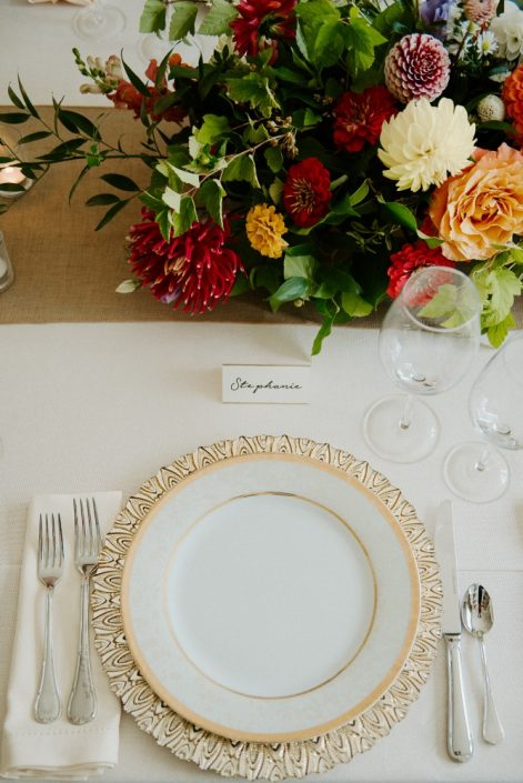 Gold-rimmed charger plate with elegant placecards and late-summer florals | Flourish & Knot | Montreal wedding florist