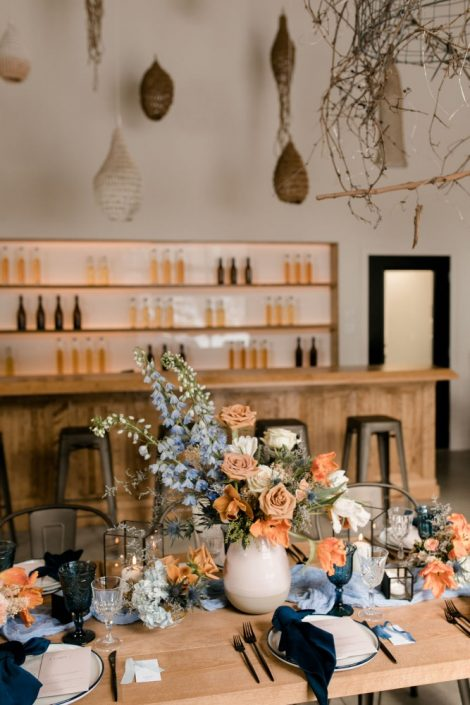 Modern boho wedding | Terracotta, orange, blue, and cream wedding table setting | Winter wedding shoot at the Verger du Flanc Nord